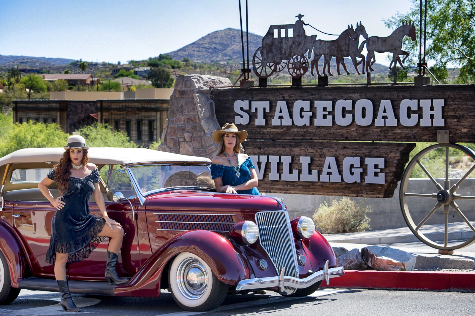 stagecoach village with antique car